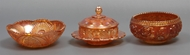 Picture of A set of two Carnival glass bowls and a butter disc