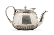 Picture of A Victorian silver tea pot of circular form