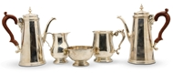 Picture of A pair of silver coffee pots and matching cream jug and sugar bowl