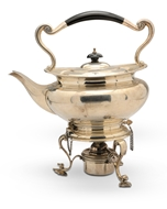 Picture of A silver tea kettle with stand and burner