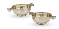 Picture of A pair of silver dishes with petalled borders