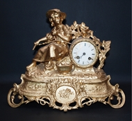 Picture of AN ENGLISH BRONZE GILDED CLOCK WITH A GIRL