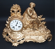 Picture of AN ENGLISH BRONZE GILDED CLOCK WITH A LADY
