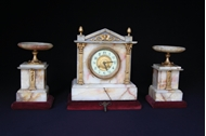 Picture of A FRENCH THREE-PIECE PINK MARBLE MANTEL CLOCK GARNITURE SET