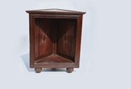 Picture of A ROSEWOOD SUNBURST CARVED CORNER RACK OF AN UNUSUAL FORM