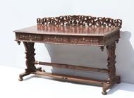 Picture of A VICTORIAN ROSEWOOD WRITING TABLE