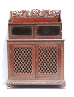 Picture of A ROSEWOOD SIDE CABINET WITH CARVED TOP FRIEZE