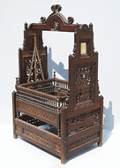 Picture of A VERY FINE ROSEWOOD HEAVILY CARVED CRADLE (PALKI)
