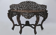 Picture of A VERY FINE CARVED INDIAN TEAKWOOD SERPENTINE CONSOLE TABLE,