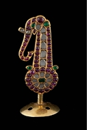 Picture of A RUBY, EMERALD, AND DIAMOND KILANGI (SARPECH) SET IN GOLD