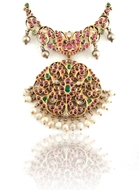 Picture of AN ATTRACTIVE RUBY, EMERALD AND SAPPHIRE OPEN WORK MEDALLION PENDANT SET IN GOLD
